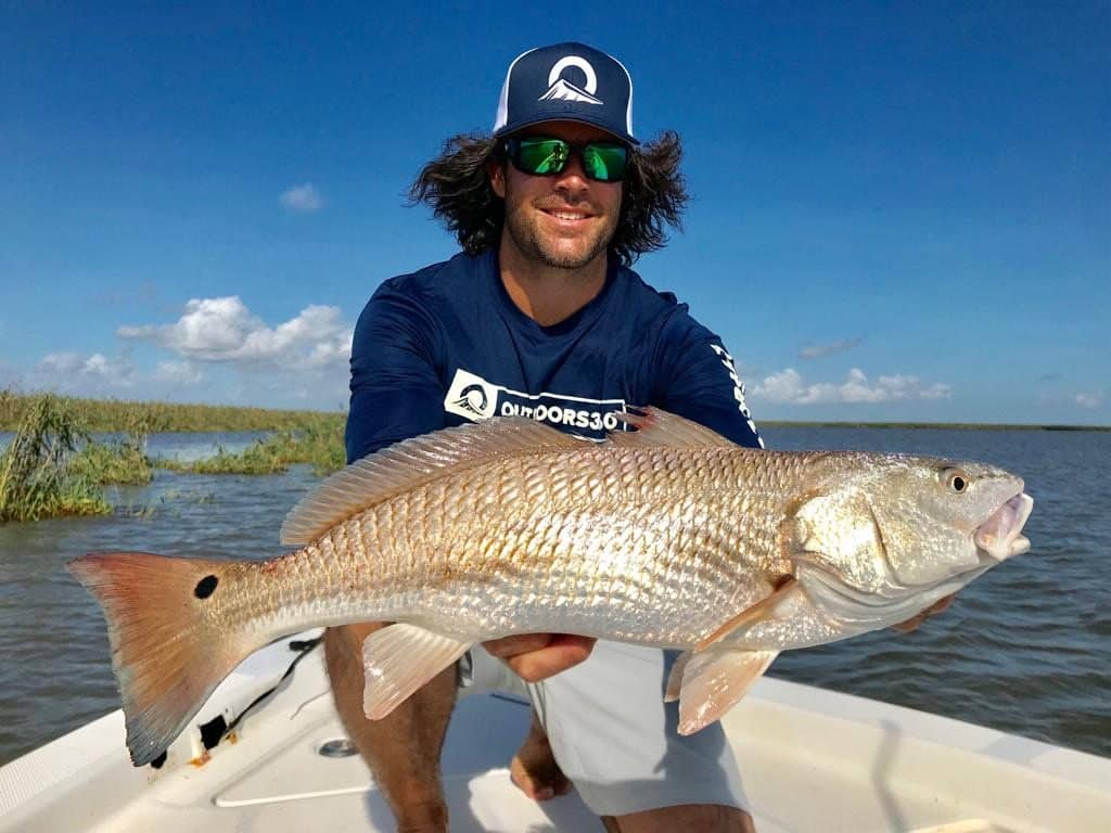 Outdoors360 Pro Staff with huge redfish