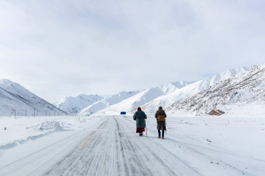 two hikers on snow area plateau