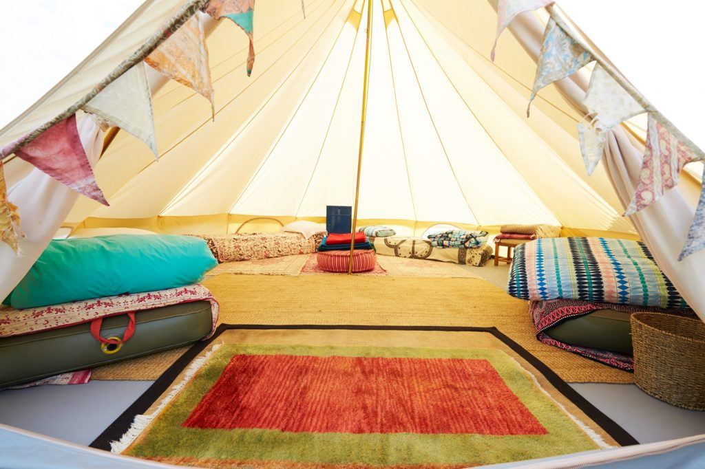 Interior View Of Teepee Tent Pitched On Glamping Camp Site With No People